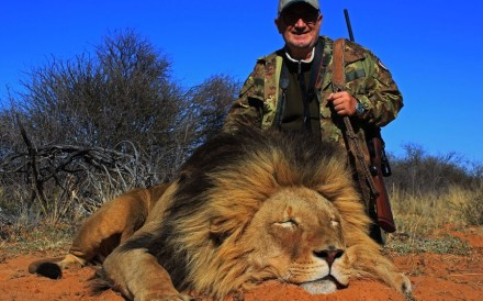A Mkulu client next to a lion he had shot. Photo: Mkulu African Hunting Safaris