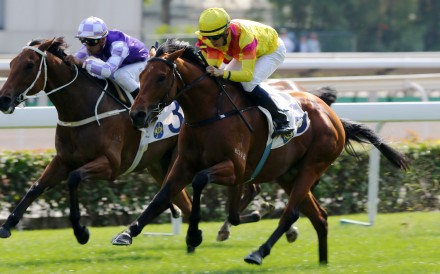 Vincent Ho guides Ho Ho Khan to victory at Sha Tin on Sunday. Photos: Kenneth Chan