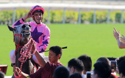 Sam Clipperton returns to scale after winning aboard Hot King Prawn. Photos: Kenneth Chan