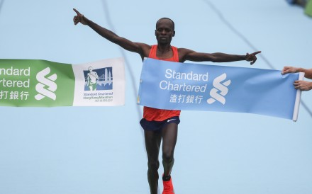 Kenya's Barnabus Kiptum breaks the course record for the men's marathon finish line in Victoria Park. 17FEB19 SCMP / Nora Tam