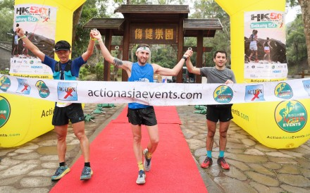 Bin Lang, Vlad Ixel and Adrian Konareff cross the finish line in joint second after losing their way thanks to markers being sabotaged in the Sai Kung 50. Photo: Action Asia