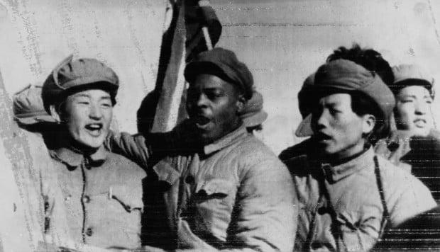 Clarence Adams with Korean prisoners of war and communist captors, in 1954. Photos: SCMP; Della Adams; UPI