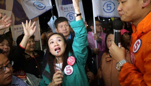 Candidates in crucial Hong Kong by-election make frantic last-minute appeals as rain puts dampener on voter turnout