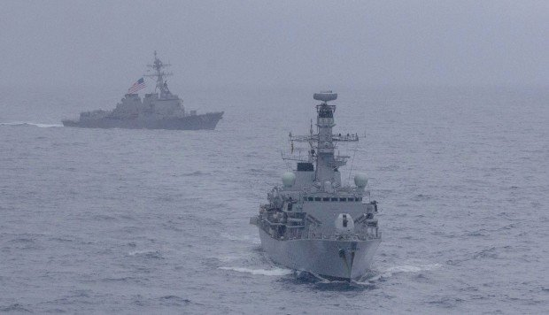 US and British navies carry out first joint drill in disputed South China Sea