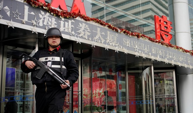 A security guard outside of the Shanghai Stock Exchange building.