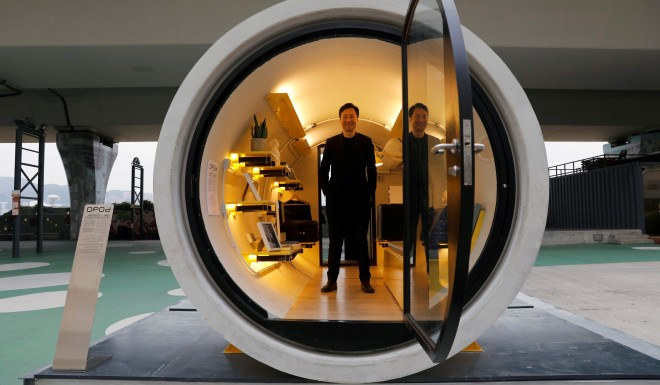 Architect James Law inside the OPod, his water pipe turned micro-flat.