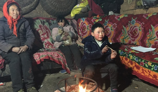 Fuman and his sister Fumei pictured at home with their grandmother Yao Chaozi.