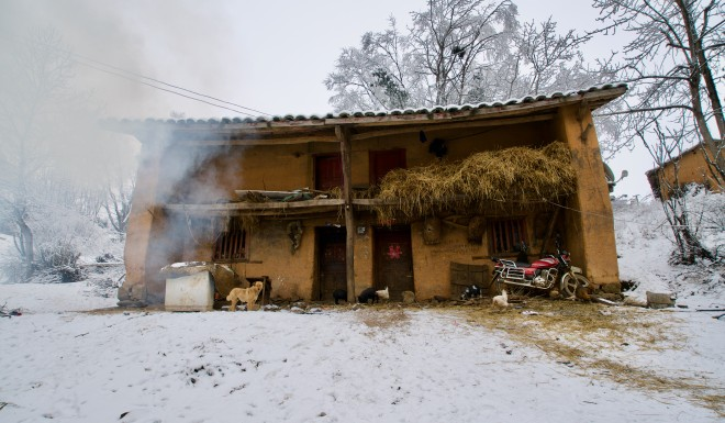 The family lives in a hut made from mud.
