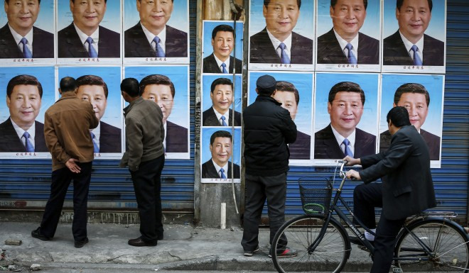 Posters of Xi Jinping, who is now able to rule China indefinitely.