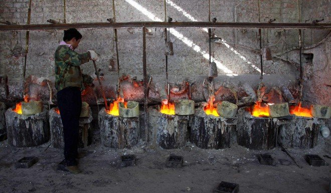 A Chinese worker smelts rare earth metals. China dominates the global supply of these materials, which have widespread applications in military tech.