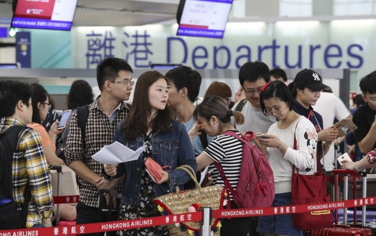 Hong Kong airport profits fall for first time in 13 years ...