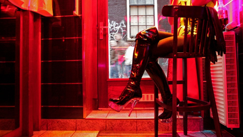 Amsterdam prostitutes protest planned shutdown of brothel