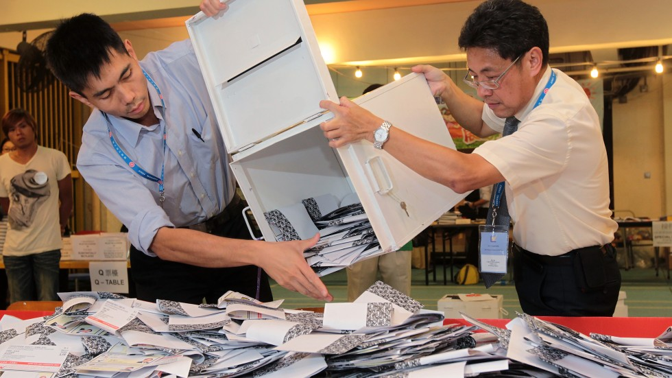 Ballot boxes being opened in Hong Kong's Legislative Council elections. Photo: South China Morning Post