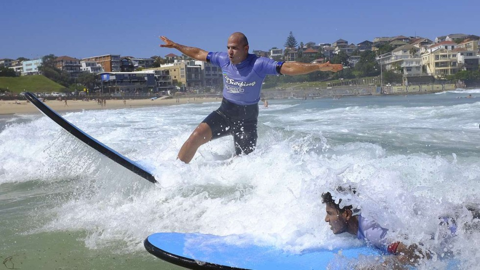 Surfing soothes asylum-seekers' fears of the sea and