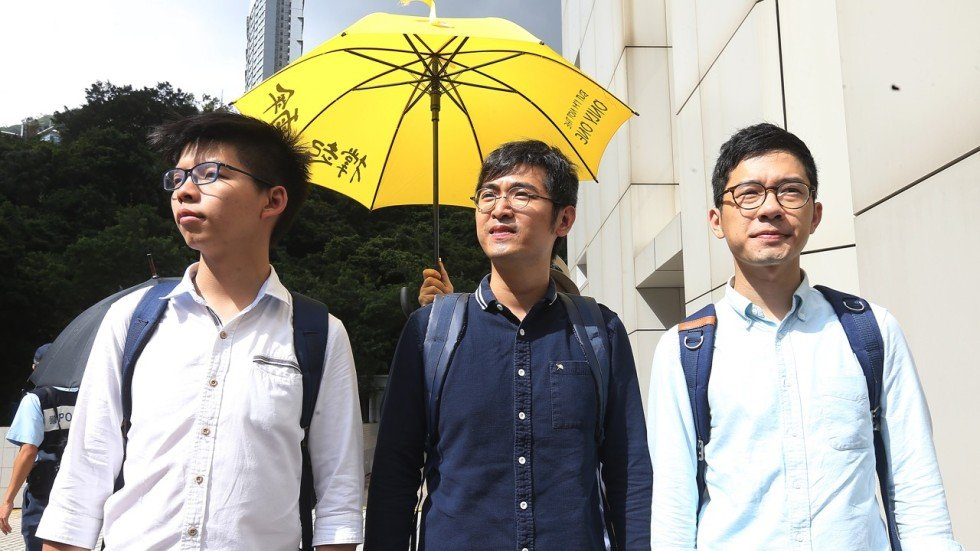 Image result for Joshua Wong, 21, Alex Chow, 27, and Nathan Law, photos