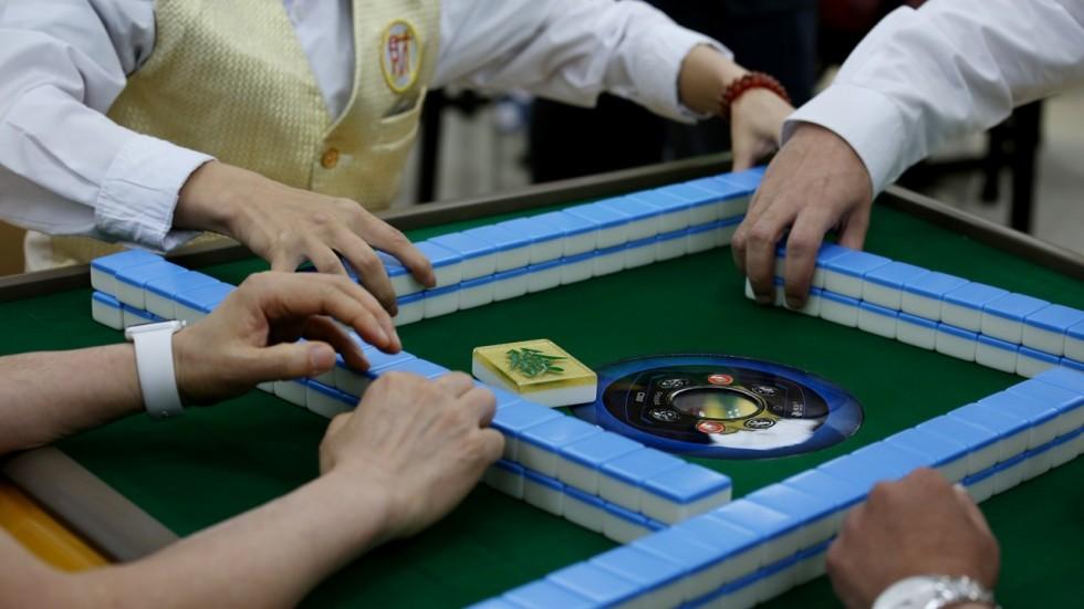 Familiar hong kong sound of mahjong tiles may be fading as more raymond yeung stopboris Gallery