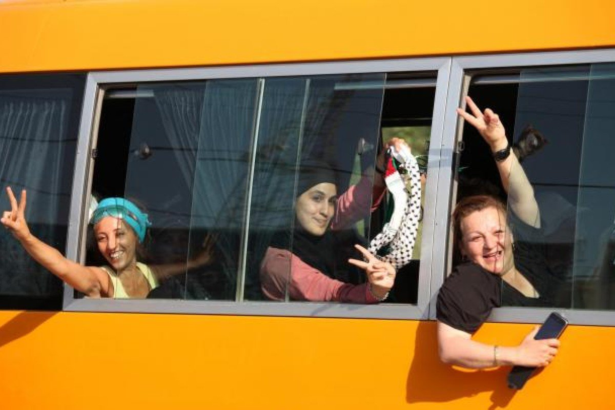 Activists from the Welcome to Palestine initiative cross the Allenby Bridge on August 26. Photo: AP