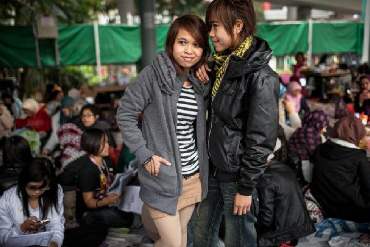 Indonesian domestic helpers Gina and Tyan in Victoria Park.