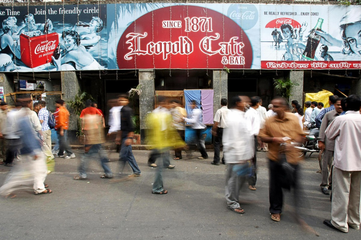 Leopold Café, which still bears bullet holes from the 2008 terrorist attack, is a popular tourist spot.