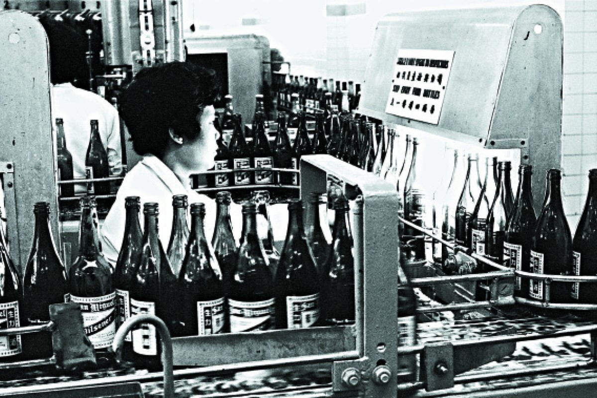 A worker processes bottles in 1973.