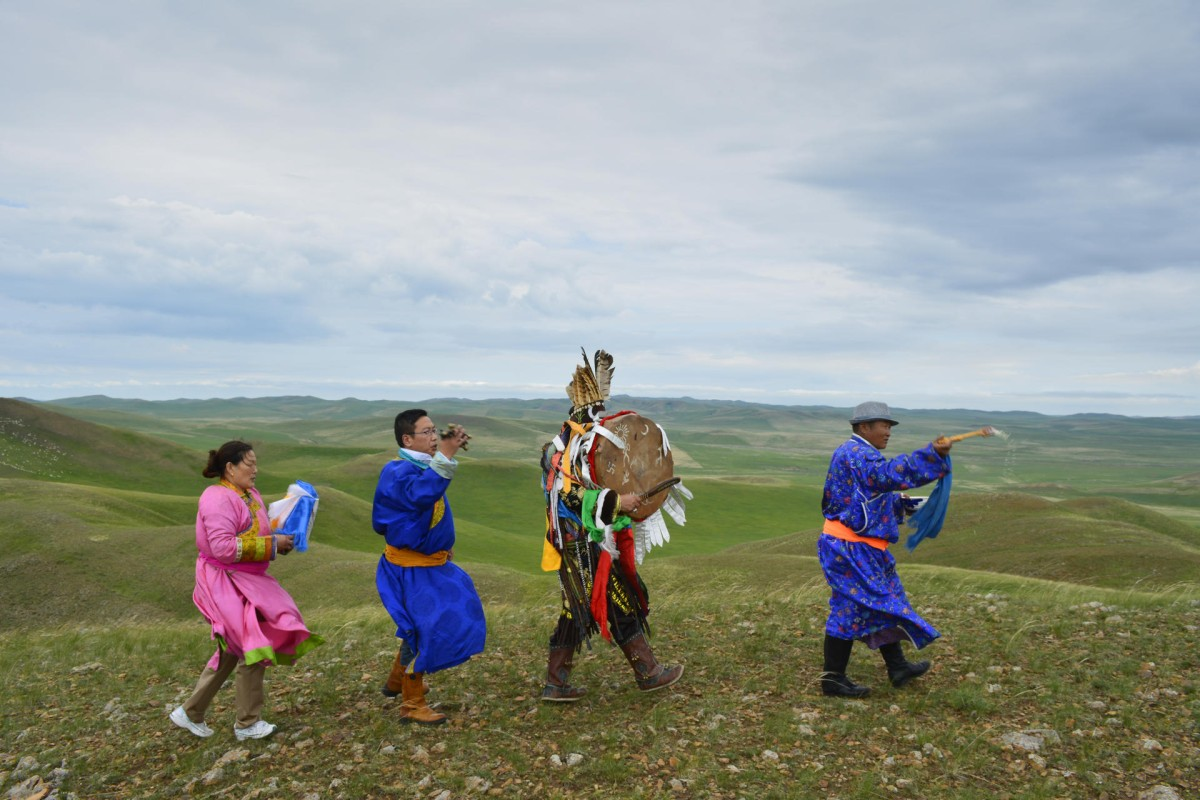 Mongolian shaman Erdemt (second from right), his wife, Oyuunbileg (far left), their son, Bao Lidao (second from left), and cousin Baater take part in an annual ritual on the grasslands near Xiwuqi.