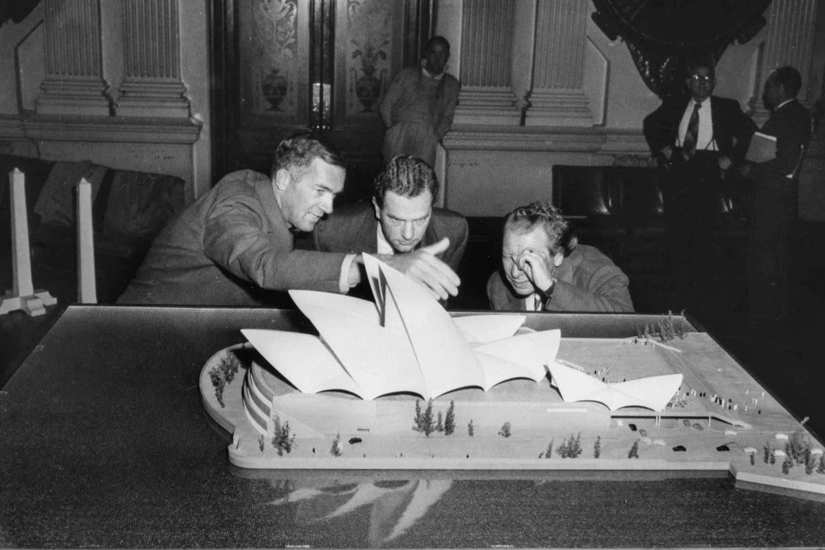 Architect Jorn Utzon (left) reveals his model of the Sydney Opera House, on July 29, 1957.
