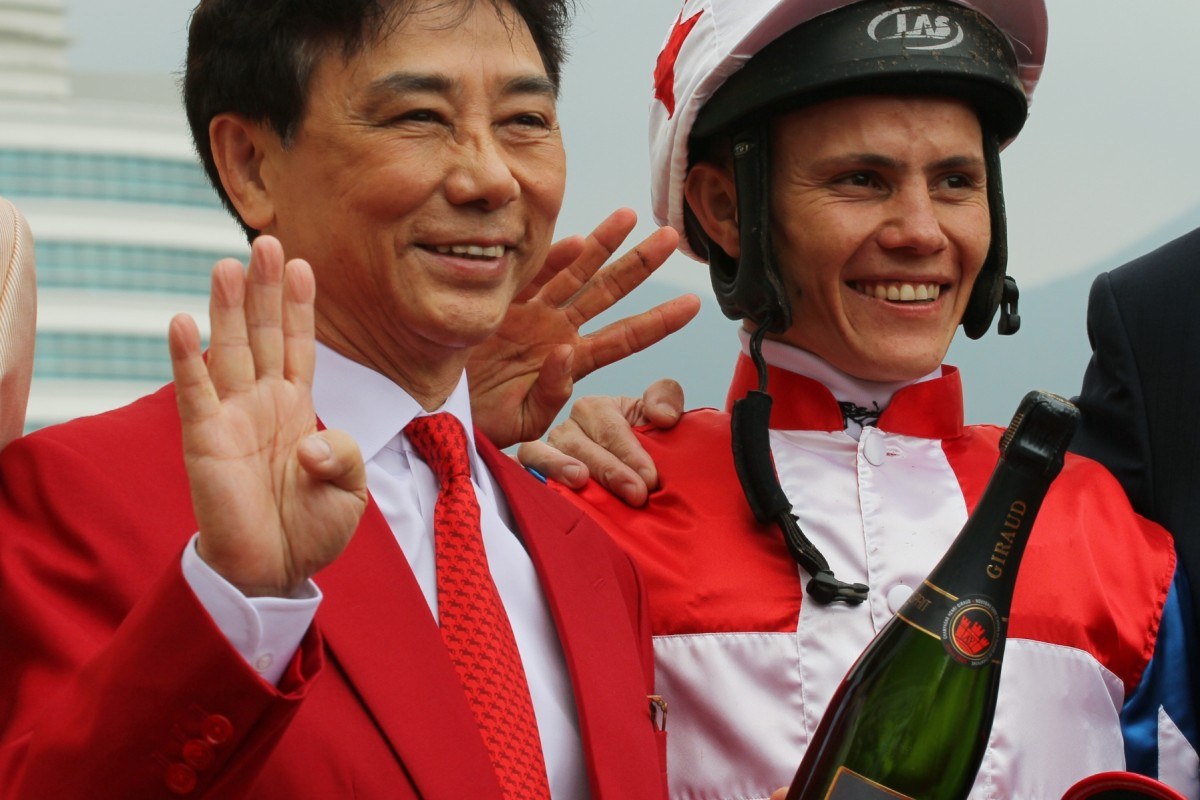 Andy Leung celebrates with Richard Fourie after they combined to win a Class Four race last season. Photo: Kenneth Chan