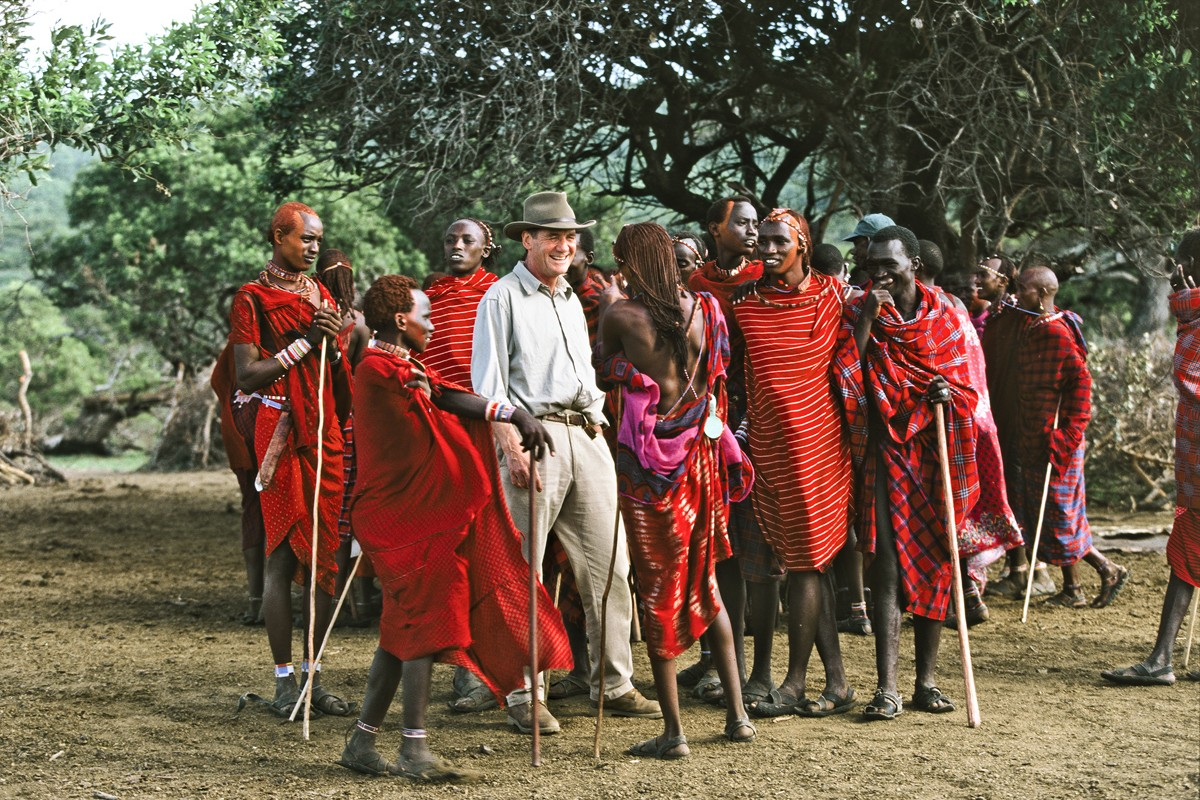 Palin with Maasai tribespeople in Chyulu Hills, Kenya, also from Hemingway Adventure.