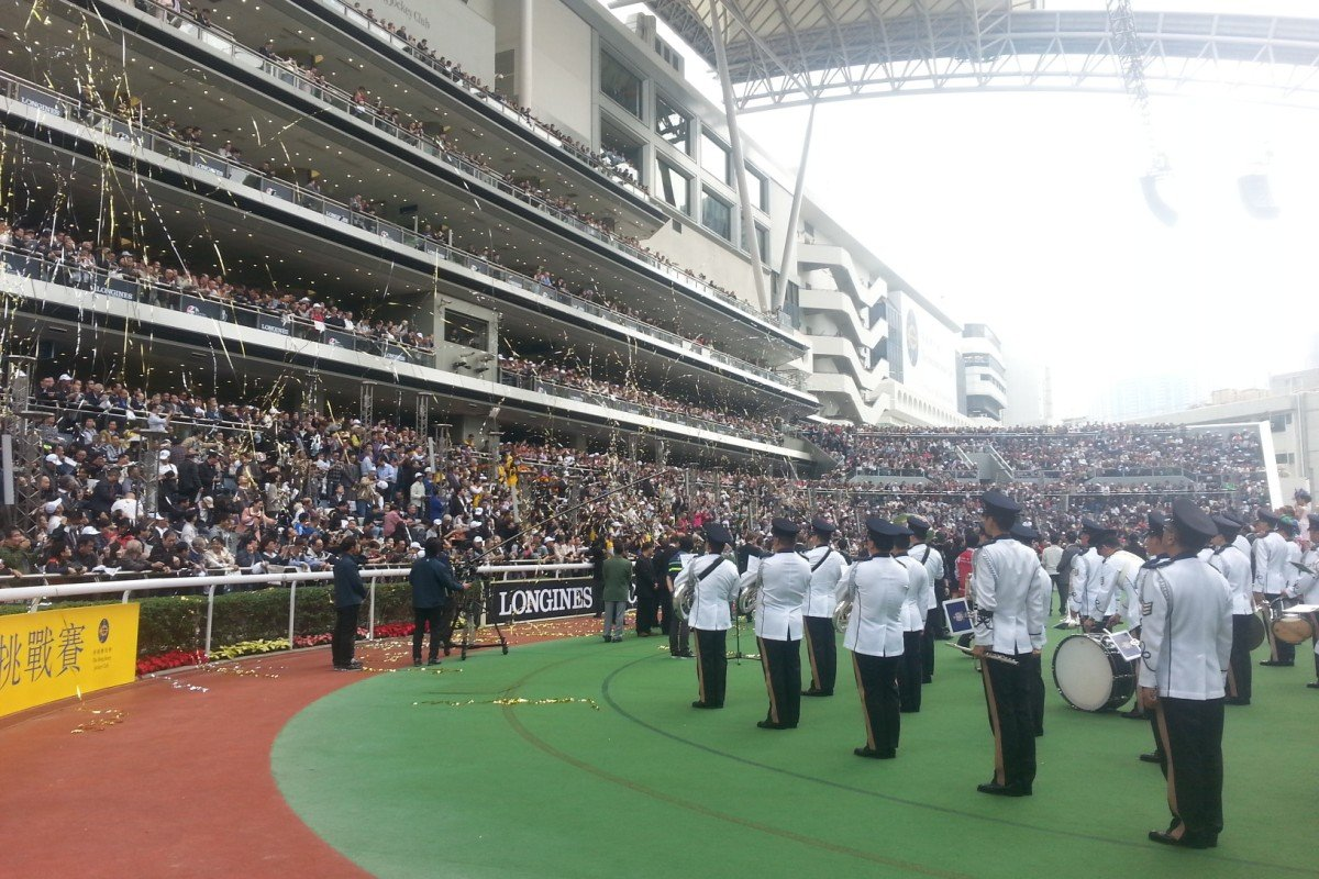 The band entertains the fans before the horses enter the parade ring.