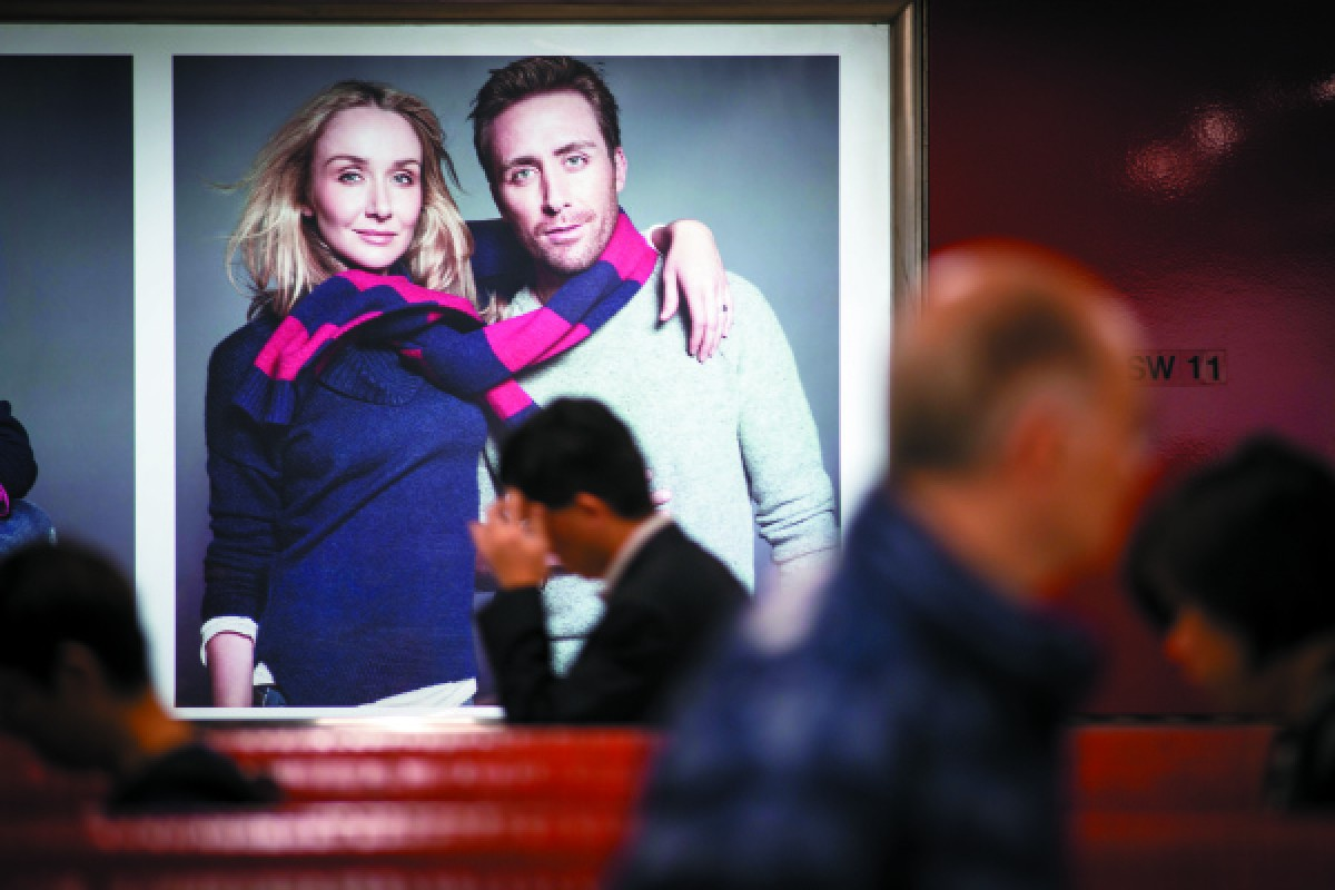 A poster for Gap featuring Cousteau and his sister, Alexandra, at Central MTR station.