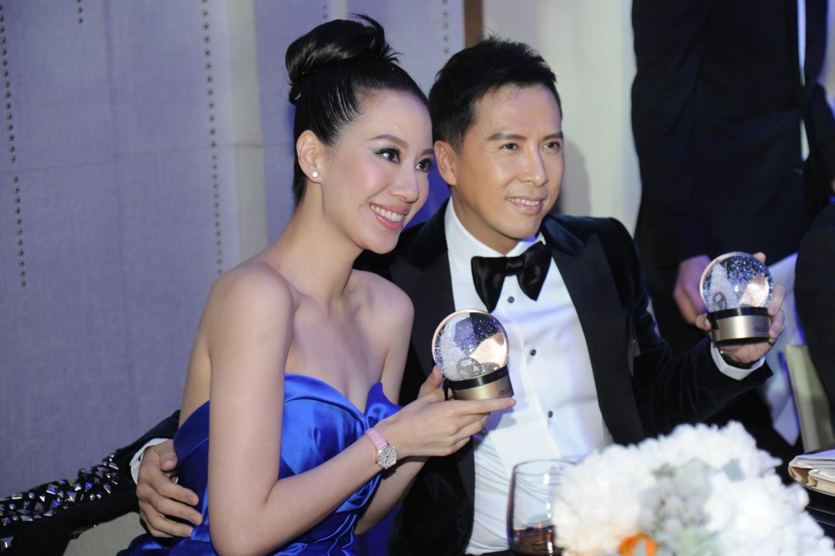 Proud parents Cissy Wang and Donnie Yen dress to the nines and enjoy a winter playground