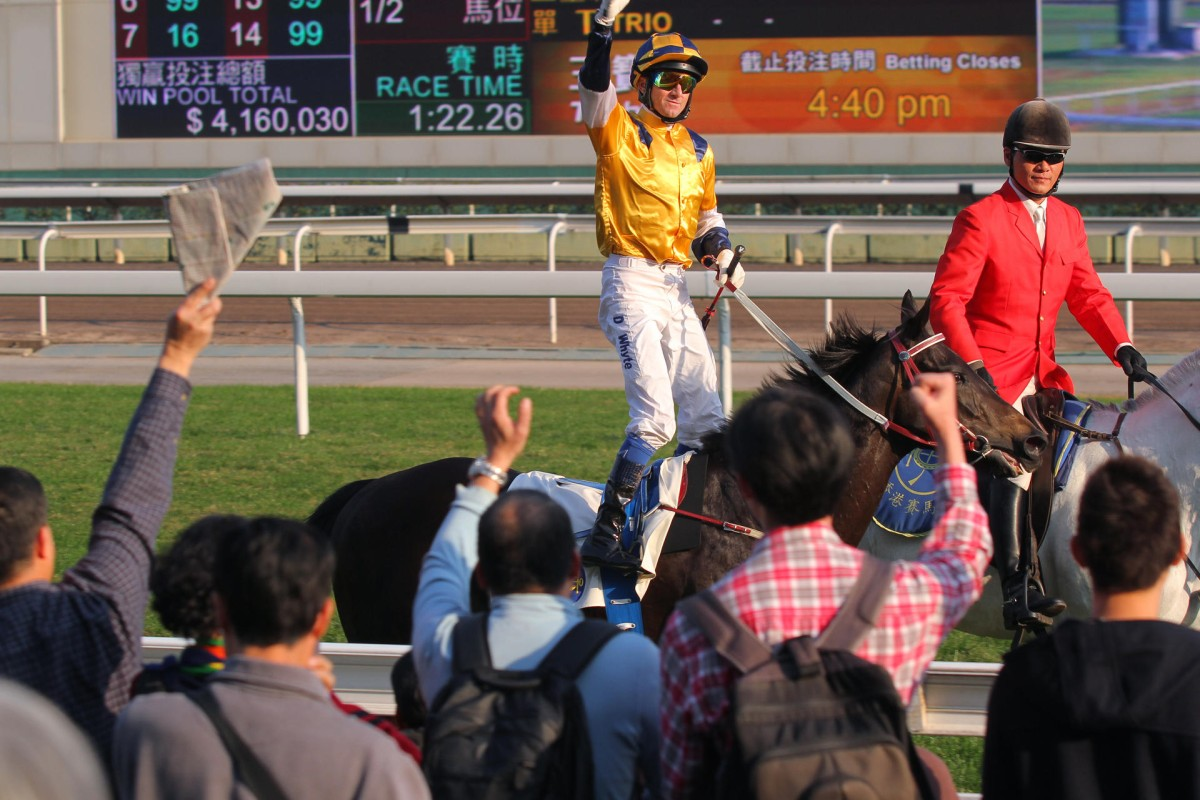 Douglas Whyte is cheered by the crowd as he brings Sterling City back to the winner's circle after his victory in the Chinese Club Challenge Cup. Photo: Kenneth Chan
