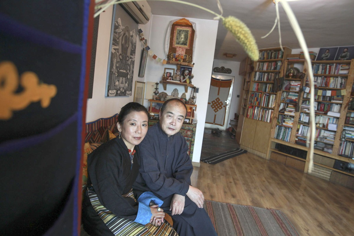 Tsering Woeser, with her husband, Wang Lixiong, at their home in Beijing. Photos: Simon Song; Corbis; AFP