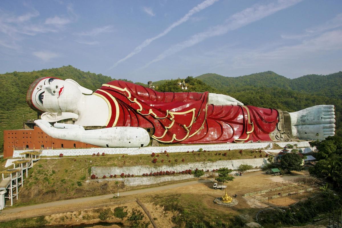 A truck is dwarfed by Win Sein Taw Ya, a 170-metre-long reclining Buddha.