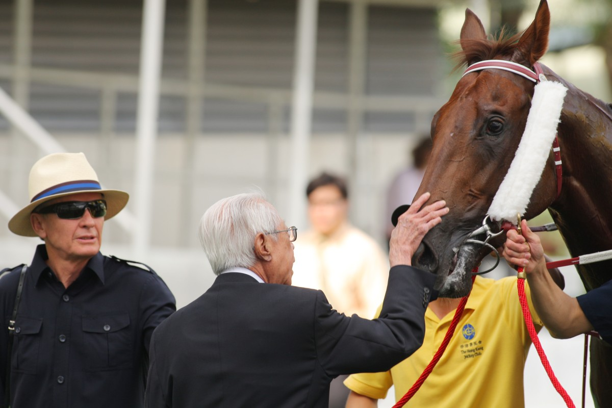 Cornel Li gives Able Friend a pat after the horse won a Class Three in June. Now, he will aim for his first Derby success. Photo: Kenneth Chan