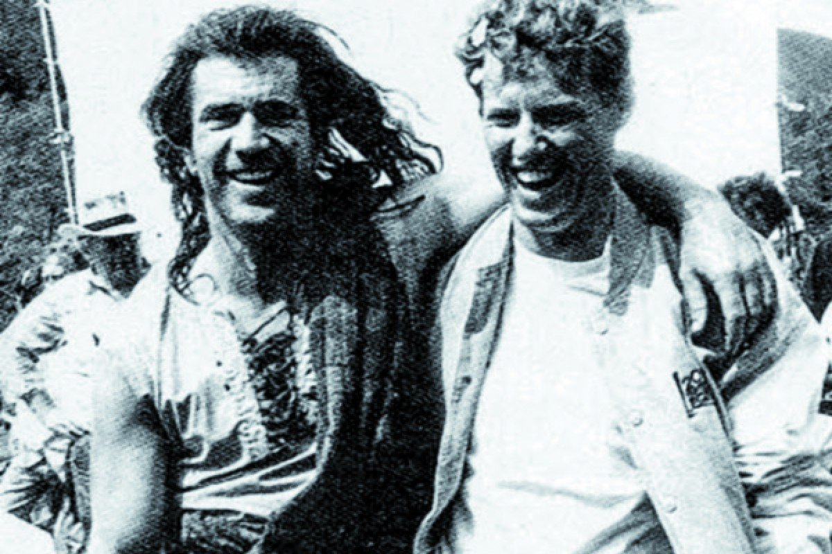 Neeson (right) with actor Mel Gibson on the set of 1995 film Braveheart.
