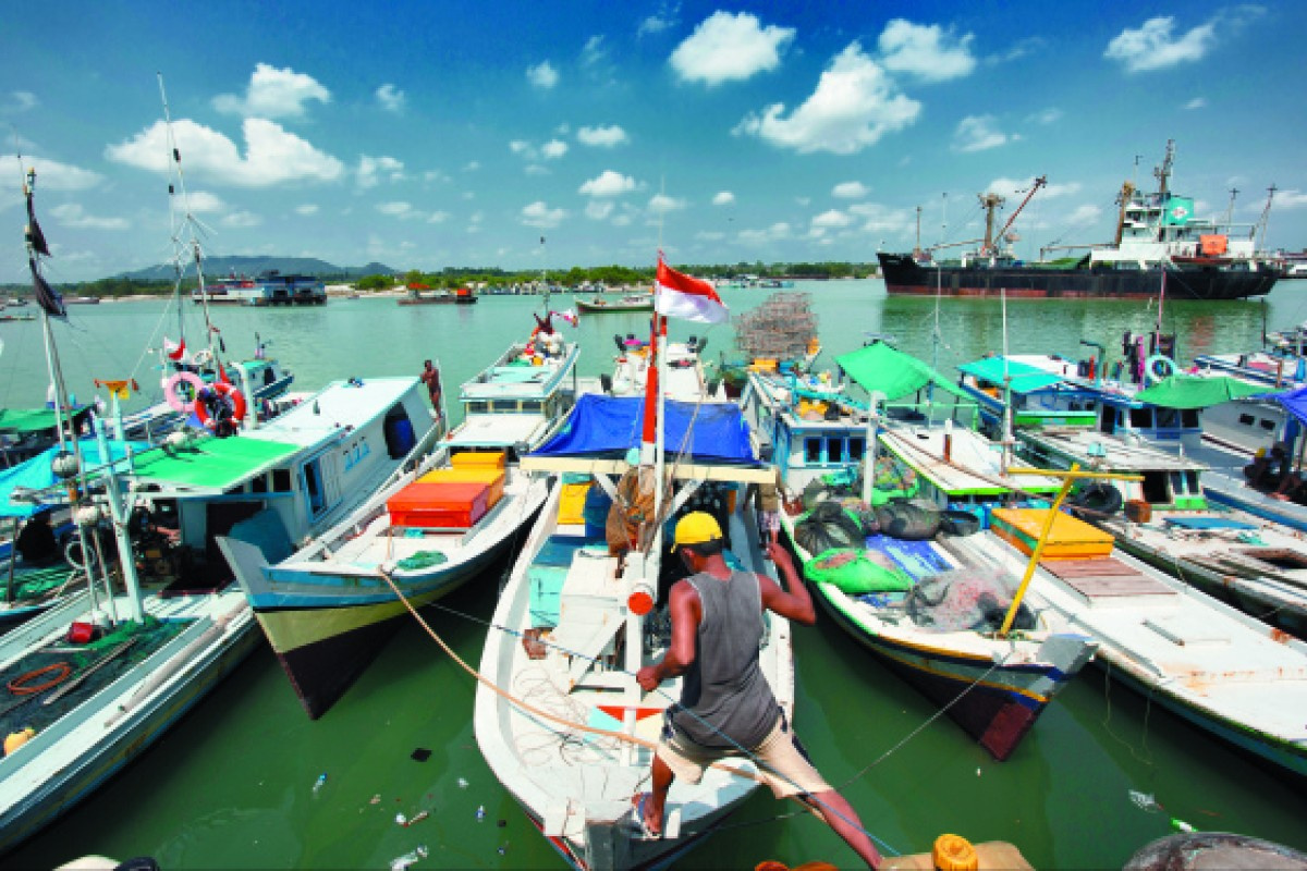 Fishing boats moored in Sungai Liat harbour. The destruction of coral reefs caused by tin mining has hurt fishermen's livelihoods by forcing fish farther out to sea.