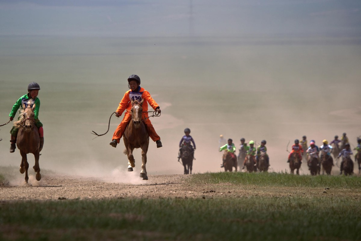 Traditional horse racing in Mongolia is a lot different: dozens of child jockeys storming across the plains for 15 kilometres. Photo: AP