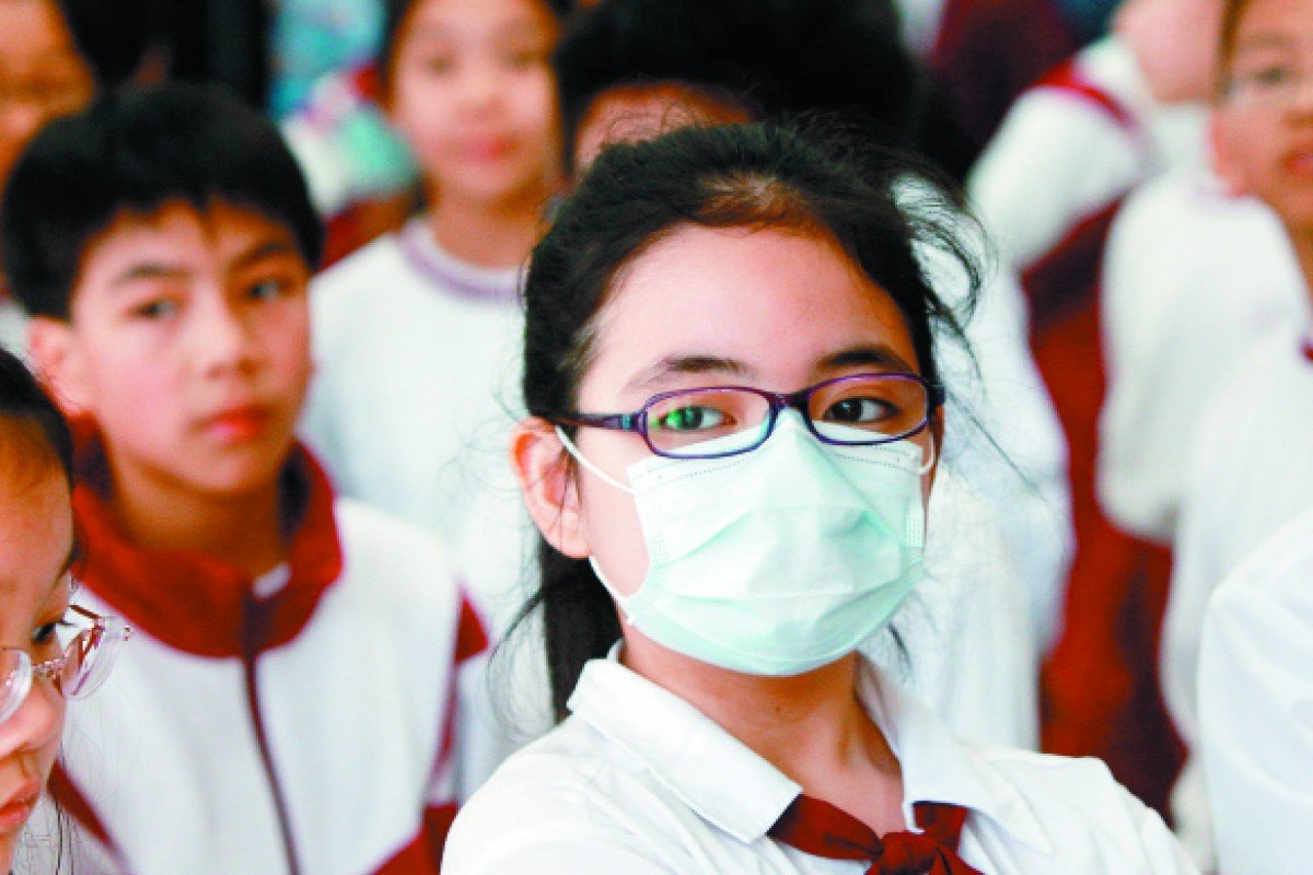 A physical-education class at a school in Mong Kok on March 23, 2010, when the air-pollution index was at a high.