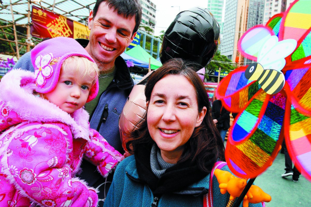 William Hayward and Sasha Haldane with their daughter, Alyssa, at a flower fair in Victoria Park, Causeway Bay, in January 2009.