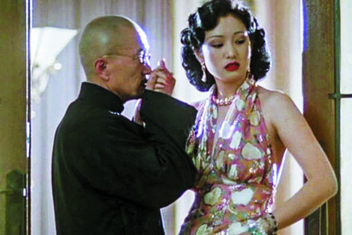 Actors Li Baotian and Gong Li in a scene from the film Shanghai Triad.