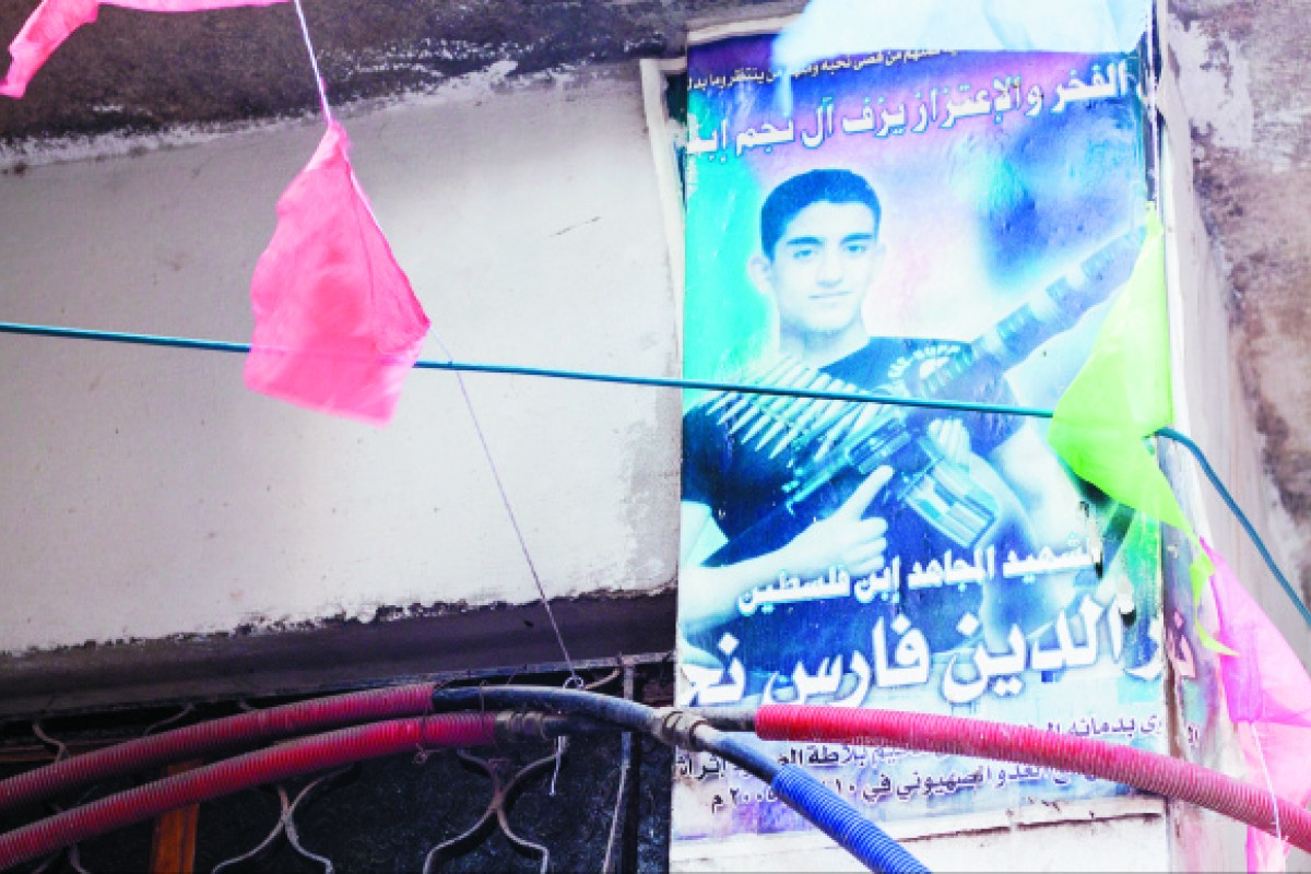 "Posters depicting ""martyred"" young men are a common sight in the West Bank's refugee camps."