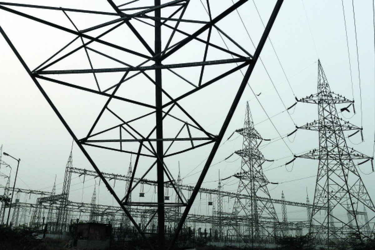 Electricity towers on the outskirts of New Delhi, India, which is struggling to deliver power to its 1.2 billion population.