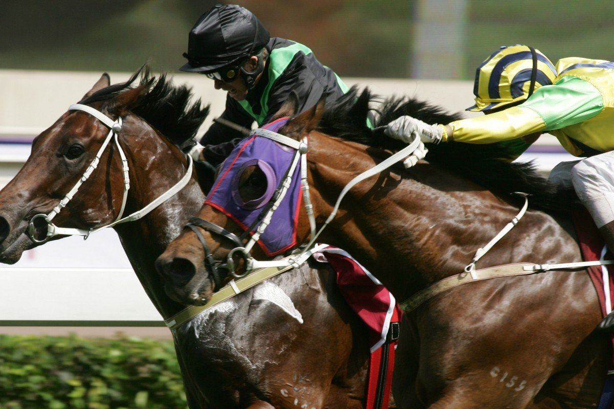 Bullish Luck and jockey Gerald Mosse swoop on hot favourite Silent Witness (Felix Coetzee) in the 2005 Champions Mile. Photos: Kenneth Chan