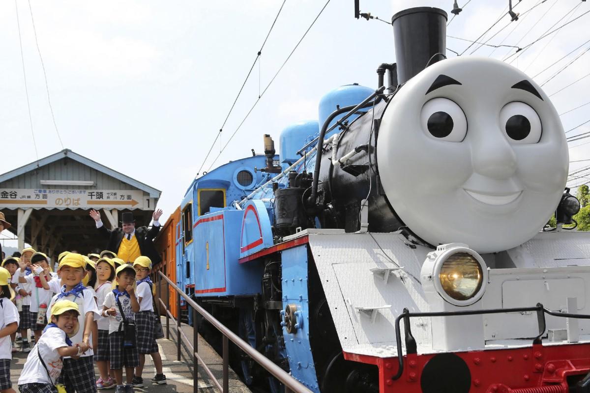 Thomas the Tank Engine pulls in at Shinkanaya station, on Japan's Oigawa Railway, in Shizuoka prefecture. Photos: AFP; Corbis