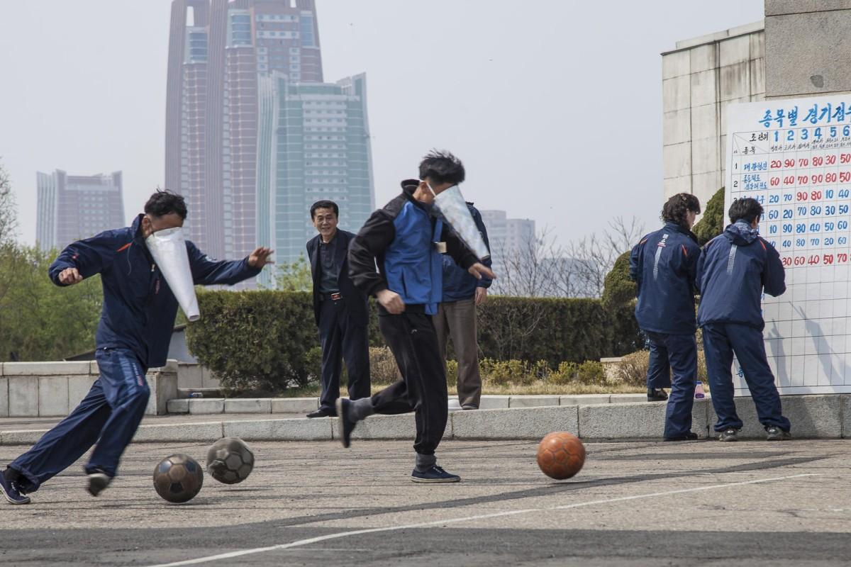 Staff from the Yanggakdo Hotel, in Pyongyang, play cone-faced football. Photos: Ayesha Sitara