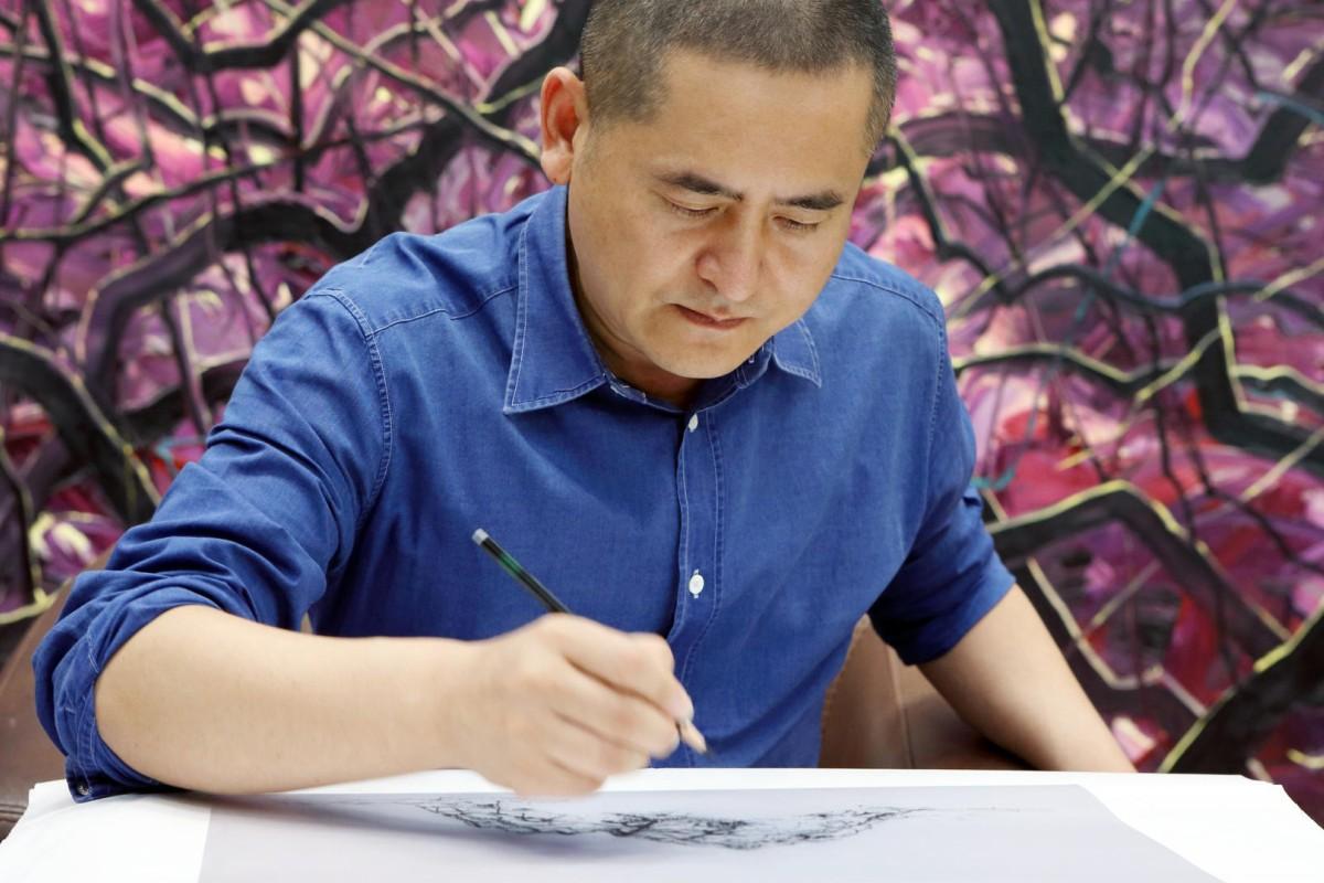 Zeng Fanzhi at work in his studio in Beijing. Zeng says painting to him is meditation. Photos: Zeng Fanzhi Studio