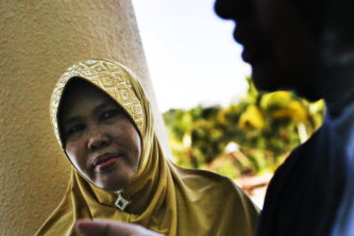 Fauziah Ariffin, the Malaysian president of the Obedient Wives Club looks on during a mass wedding ceremony in conjunction with the club's launch in Kuala Lumpur, on June 4, 2011. Rahman Roslan