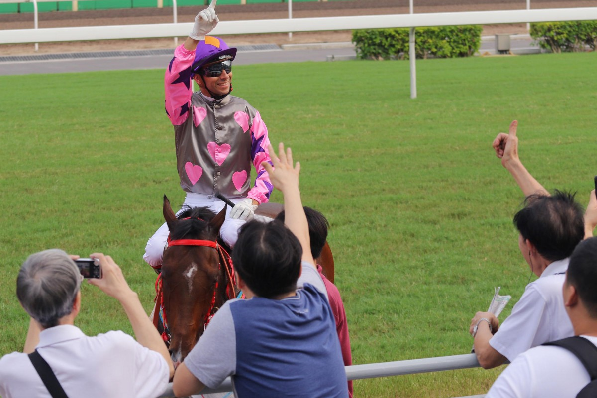 Joao Moreira returns to the winner's circle on Amazing Kids, to the delight of punters trackside at Sha Tin. It was the fourth of five winners for the jockey. Photos: Kenneth Chan
