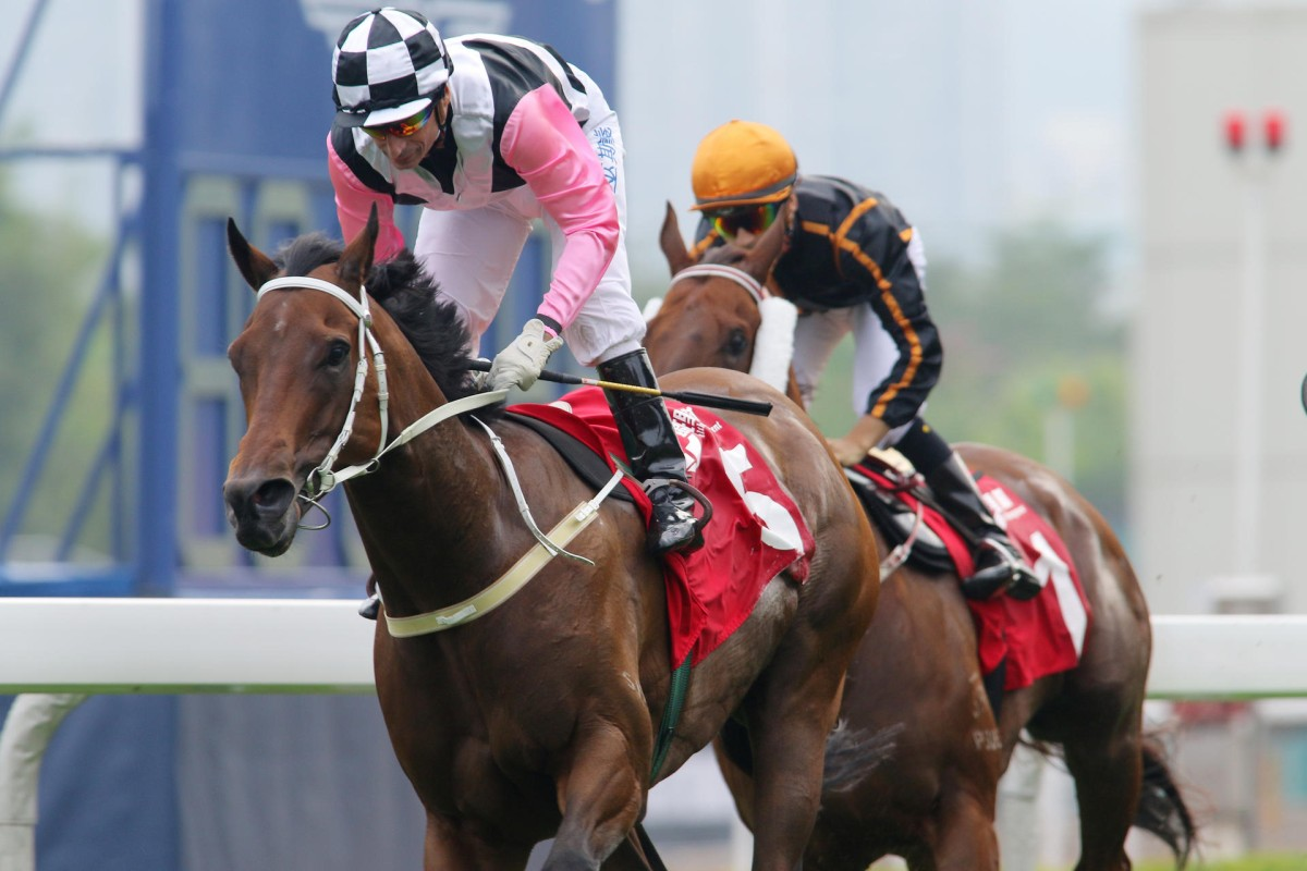 Beauty Flame (Gerald Mosse) wins the Jockey Club Mile comfortably, with hot favourite Able Friend (Joao Moreira) running on for third along the rail. Photo: Kenneth Chan